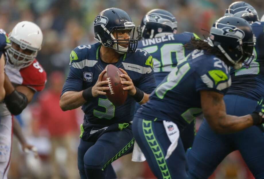 3. Russell Wilson's ability to make plays  Seahawks quarterback Russell Wilson has convinced us all of his ability to make something out of nothing when he is able to scramble out of the pocket. He can squirt through the arms of would-be sackers and pick up first downs, not just with his arm but with his legs. Unfortunately for Seattle, he hasn't had ample protection for the past three weeks, as the 49ers were able to contain Wilson inside the pocket, as were the Giants and Cardinals. When Wilson can't do his thing, the Seahawks become a much less dynamic offense.  Wilson and the O-line face perhaps their most challenging foe this Sunday against the Rams, who have the third-most (49) sacks in the NFL. That said, despite their suffocating run defense and a defensive line that can rattle even the most seasoned quarterbacks, the Rams have only the 20th-ranked passing defense in the league. They are giving up 247.7 passing yards per tilt and have allowed opposing QBs to complete 68.3 percent of their passes -- ranking St. Louis first (in a bad way) in opponent completion percentage. If Wilson can find an early rhythm with his receivers and force the Rams to respect the pass, Seattle ought to be able to make some big plays. If not -- well, you saw what happened last Sunday, when the Cardinals shocked the Hawks 17-10. Photo: Otto Greule Jr, Getty Images