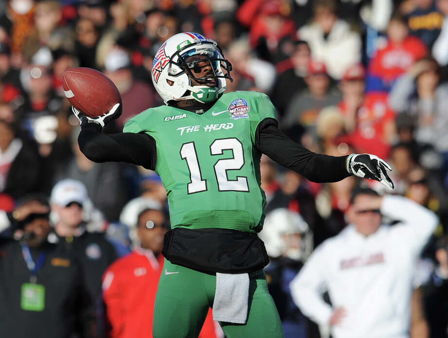 Marshall's quarterback Rakeem Cato throws in the first half of the Military Bowl NCAA college football game against Maryland, Friday, Dec. 27, 2013 in Annapolis, Md. Marshall won 31-20. Cato was the game MVP. (AP Photo/Gail Burton) ORG XMIT: MDGB112 Photo: Gail Burton / FR4095 AP