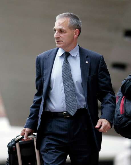 Former FBI Director Louis Freeh, left, leaves Federal Court after meeting with U.S. District Judge Carl Barbier in New Orleans, Tuesday, July 2, 2013. Barbier appointed Freeh to investigate alleged misconduct by a lawyer who helped run BP's multibillion-dollar settlement fund. (AP Photo/Gerald Herbert) Photo: Gerald Herbert, STF / AP