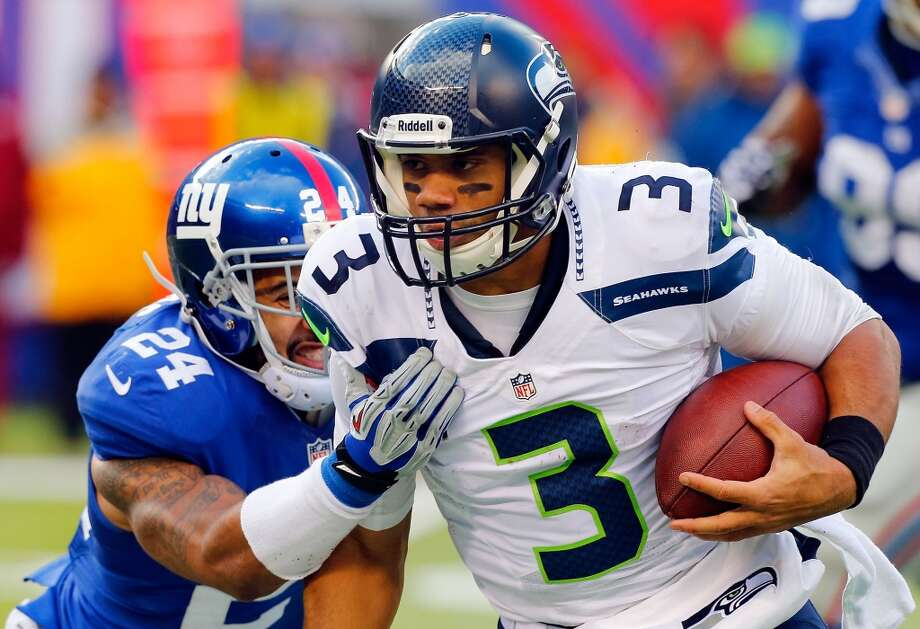 Russell Wilson — quarterbackRussell Wilson earned a spot in the Pro Bowl again this year after playing as an alternate last January. In his second pro season, Wilson has remained a steady and explosive force on Seattle's offense, passing for 3,185 yards, 25 touchdowns and just nine interceptions while completing 63.0 percent of his throws. Photo: Jim McIsaac, Getty Images