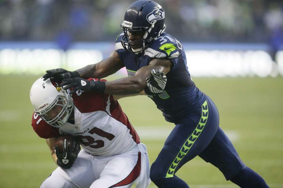 Kam Chancellor — strong safety  Seattle's other starting safety, Kam Chancellor, returns to the Pro Bowl (he made it in 2011) after a monster season. Through 15 games, Chancellor has made three interceptions, defended six passes and has collected 85 total tackles this year. Photo: Stephen Brashear, AP