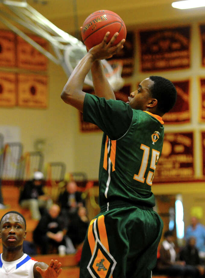 Trinity Catholic's Tyrell St. John, during Northeast 2013 Catholic Classic basketball tournament action against St. Francis Prep in Stratford, Conn. on Friday December 27, 2013. Photo: Christian Abraham / Connecticut Post