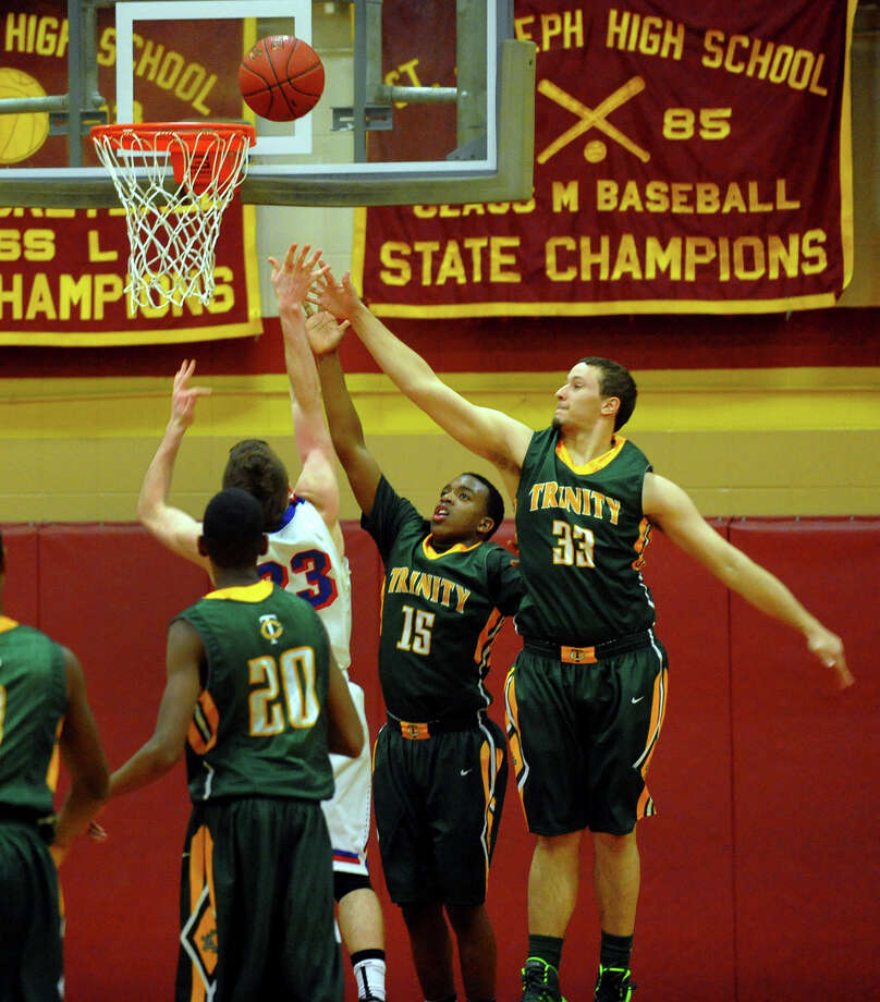 Northeast 2013 Catholic Classic basketball tournament action between Trinity Catholic and St. Francis Prep in Stratford, Conn. on Friday December 27, 2013. Photo: Christian Abraham / Connecticut Post