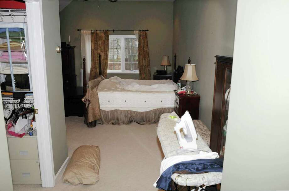 "This photo released by the Connecticut State Police on Friday, Dec. 27, 2013, and contained in a document titled ""Sec 4 -Scene Search Day 3,"" shows a room in the home where Adam Lanza lived with his mother in Newtown, Conn. Lanza gunned down 20 first-graders and six educators with a semi-automatic rifle at Sandy Hook Elementary School on Dec. 14, 2012, in Newtown, after killing his mother inside their home. Lanza committed suicide with a handgun as police arrived at the school. (AP Photo/Connecticut State Police) ORG XMIT: BX122 / Connecticut State Police"