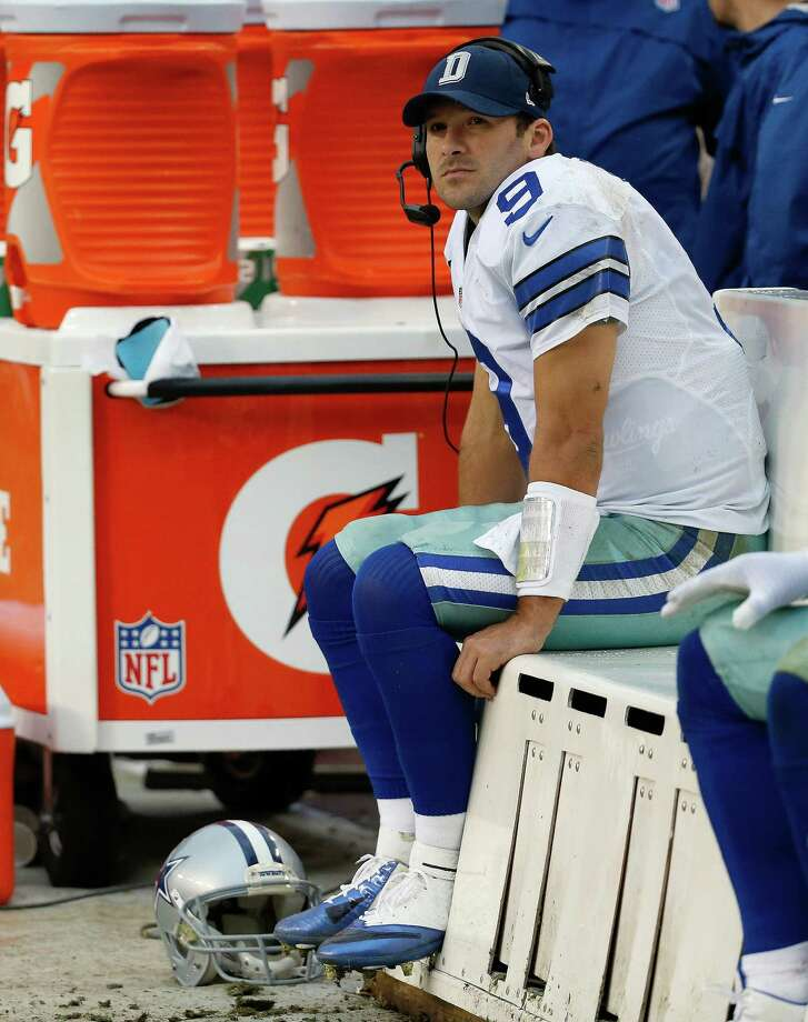 Dallas Cowboys quarterback Tony Romo seats on the beach as watches the action on the big screen television during the second half of an NFL football game against the Washington Redskins in Landover, Md., Sunday, Dec. 22, 2013. (AP Photo/Alex Brandon) ORG XMIT: FDX117 Photo: Alex Brandon / AP