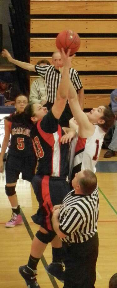 Kaitlin McKenna, right, of Fairfield Warde, and Sabrina Rodriguez, of Brien McMahon, in the opening tipoff Friday, Dec. 27 of the annual Todd Burger Girls Holiday Tournament at Fairfield Ludlowe. Warde beat McMahon 78-28 to advance to Monday's basketball final against Ludlowe, a 57-32 winner over Brookfield. Photo: Reid L. Walmark / Fairfield Citizen