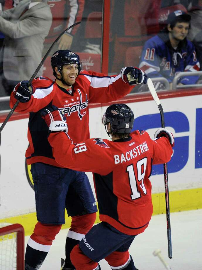 Washington Capitals right wing Eric Fehr, left, celebrates his goal with Nicklas Backstrom (19), of Sweden, during the third period an NHL hockey game against the New York Rangers, Friday, Dec. 27, 2013, in Washington. The Capitals won 3-2. (AP Photo/Nick Wass) ORG XMIT: VZN110 Photo: Nick Wass / FR67404 AP