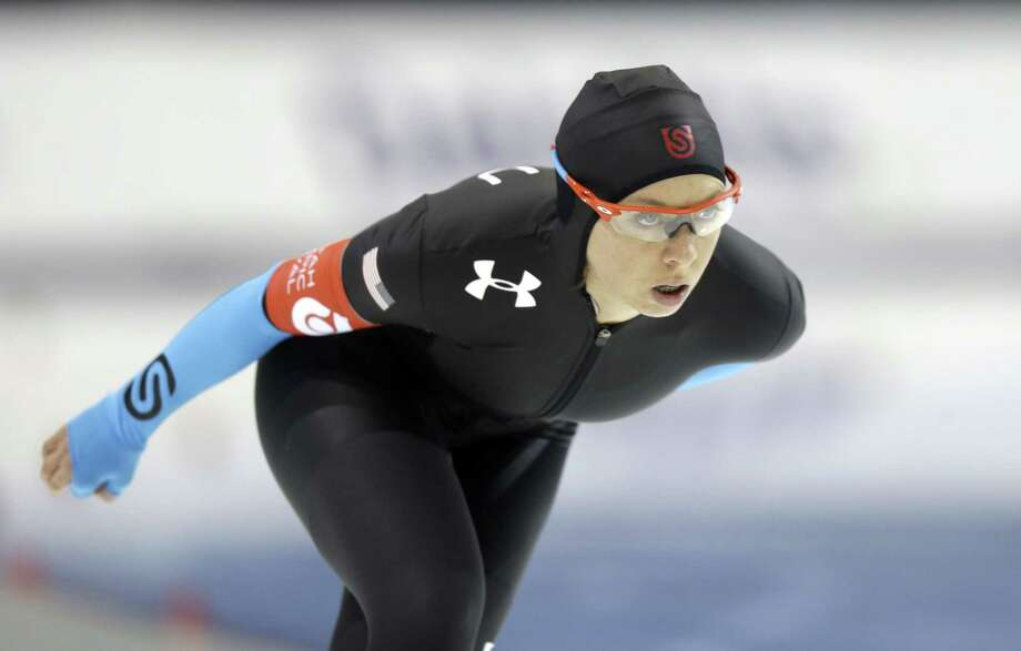 Jilleanne Rookard competes in the women's 3,000-meter during the U.S. Olympic speedskating trials on Friday, Dec. 27, 2013, in Kearns, Utah. Rookard came in first place. (AP Photo/Rick Bowmer)  ORG XMIT: UTRB101 Photo: Rick Bowmer / AP