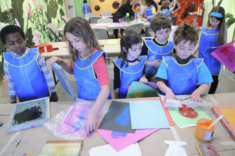Young artists learn about printmaking with a hands-on workshop Friday at the Bruce Museum in Greenwich. Photo: Keelin Daly, Contributed / Stamford Advocate Freelance