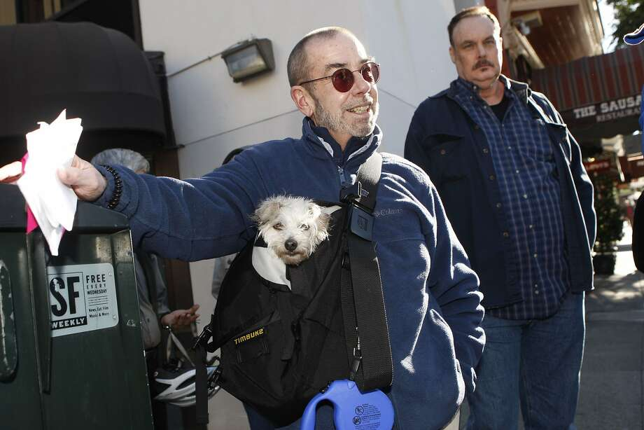 San Francisco director of the tenants union Ted Gullicksen with his dog Falcor (left) and tenant Jeremy Mykaels  (right) protest Ellis Act evictions in San Francisco, California, on Wednesday,  December 19, 2012. Photo: Liz Hafalia, The Chronicle
