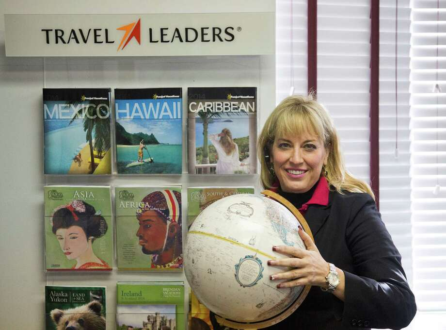 Michelle Weller, a Travel Leaders spokeswoman in Houston, says many travelers are prebooking almost a year in advance. Photo: Thomas B. Shea / © 2013 Thomas B. Shea