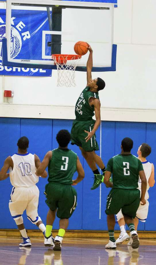 Green Tech's TyQuavius McGill dunks the ball against Shaker during the Julius Girmindl/Pep Sand boys basketball tournament, Friday, Dec. 27, 2013 in Latham, N.Y. (Dan Little/ Special to the Times Union) Photo: Dan Little / Copyright Dan Little