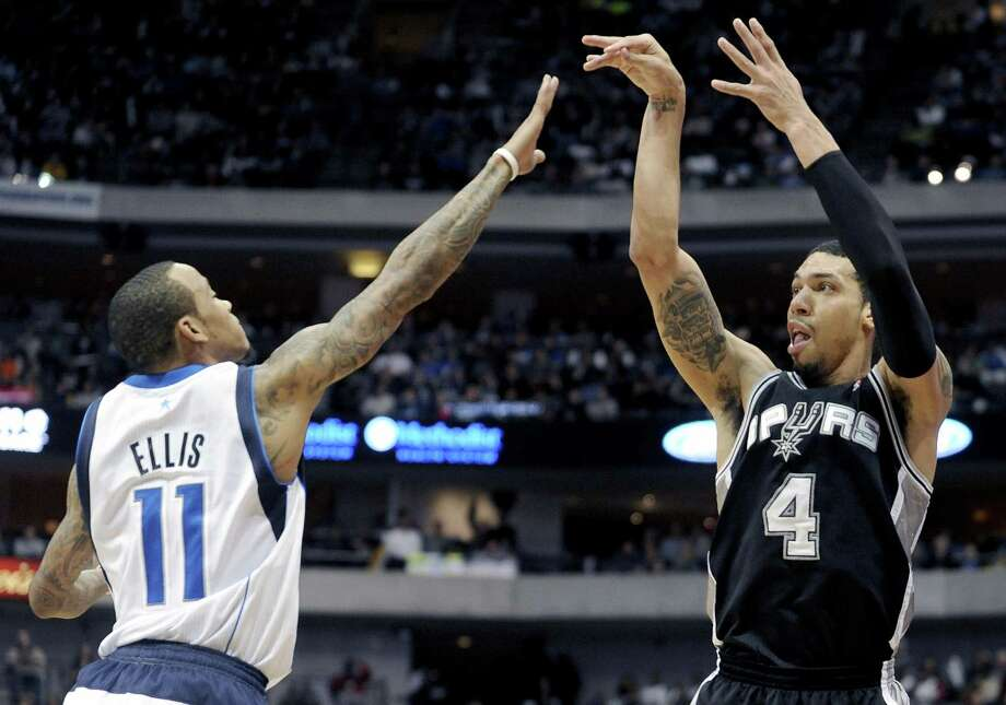 The Spurs' Danny Green, shooting over Monta Ellis, made all seven of his shots — including five threes — for 22 points in Thursday's win over Dallas. Green moved to the bench Dec. 18. Photo: Matt Strasen / Associated Press / FR170476 AP