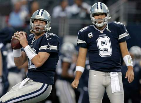 In this Nov. 28, 2013, photo, Dallas Cowboys quarterbacks Kyle Orton (18) and Tony Romo (9) warm up for an NFL football game against the Oakland Raiders in Arlington, Texas. Orton will make his first start at quarterback in his two seasons with the Cowboys on Sunday night, Dec. 29, unless Romo can recover from a herniated disc. Dallas will be playing a winner-take-all game at home against the Philadelphia Eagles for the NFC East title and a playoff berth. (AP Photo/Brandon Wade) Photo: Brandon Wade, Associated Press / FR168019 AP