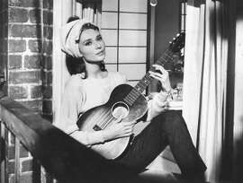 "Audrey Hepburn sings ""Moon River"" in ""Breakfast at Tiffany's"""