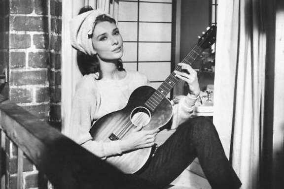 """Audrey Hepburn sings """"Moon River"""" in """"Breakfast at Tiffany's"""""""