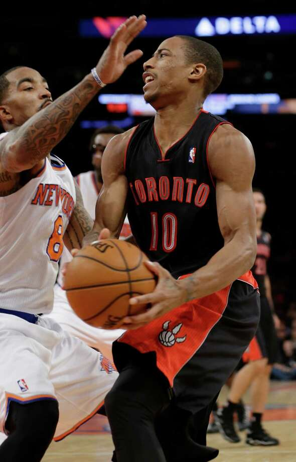 Toronto Raptors' DeMar DeRozan (10) drives past New York Knicks' J.R. Smith (8) during the second half of an NBA basketball game Friday, Dec. 27, 2013, in New York. The Raptors won the game 95-83. (AP Photo/Frank Franklin II) ORG XMIT: MSG109 Photo: Frank Franklin II / AP