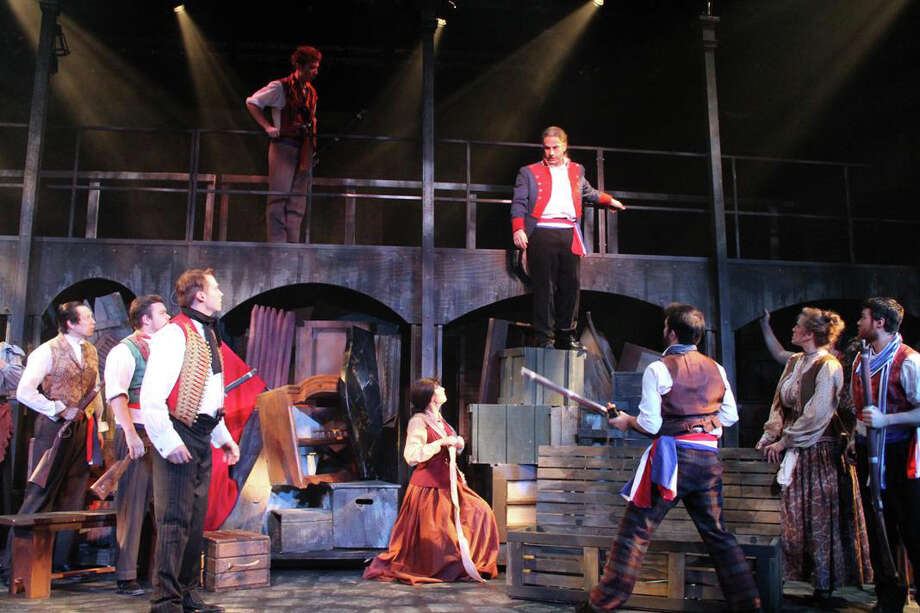 ìLes Miserablesî is on stage at the White Plains Performing Arts Center through Tuesday. In the photo above, Kyle Pressley (left, foreground) is Enjolras and Joseph C. Bellino (top, background) is Javert. Photo: Contributed Photo/Kathleen Davis, Contributed Photo / Connecticut Post Contributed
