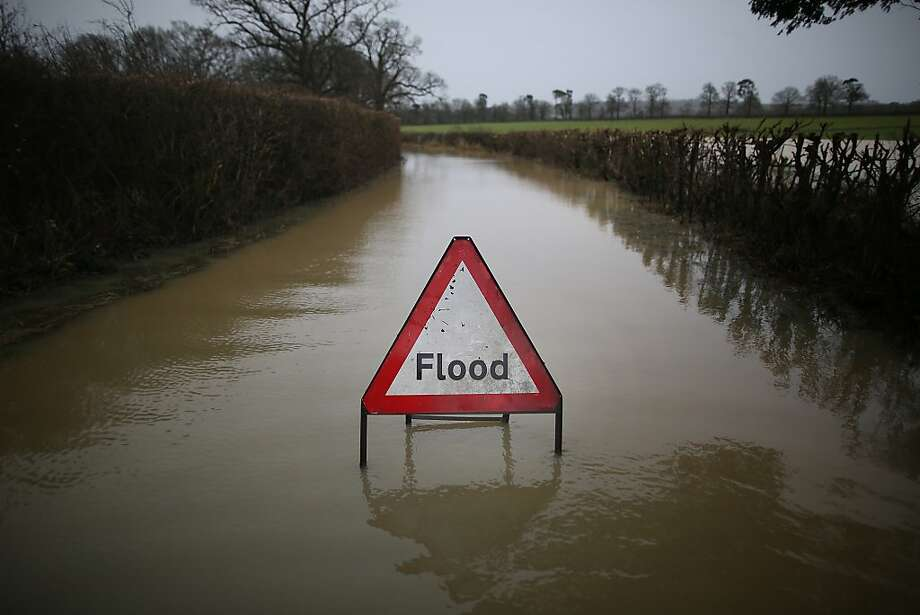 LINGFIELD, UNITED KINGDOM - DECEMBER 27:  A council sign sits in flood water on a road near Lingfield on December 27, 2013 in England. High winds and flooding are continuing to cause problems in parts of southern England. Some homes are still without power.  (Photo by Peter Macdiarmid/Getty Images) *** BESTPIX *** Photo: Peter Macdiarmid, Getty Images