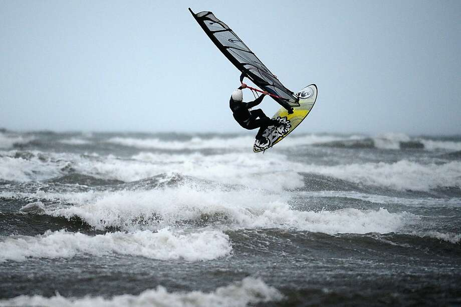 TROON, SCOTLAND - DECEMBER 27:  Windsurfer Alan Coutts braves the strong winds at Troon beach on December 27, 2013 in Troon, Scotland. A yellow 'be aware' warning has been issued for many parts of Scotland as the country is affected by gale force winds and heavy rain.  (Photo by Jeff J Mitchell/Getty Images) *** BESTPIX *** Photo: Jeff J Mitchell, Getty Images