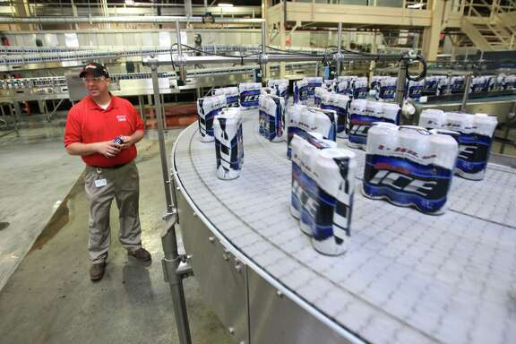 Scott Vail, the Anheuser-Busch InBev plant general manager, inspects the packaging area of the Houston brewery that's near Interstate 10 and the East Loop.
