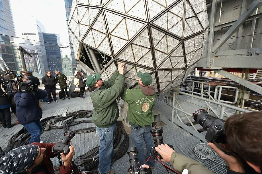 NEW YORK, NY - DECEMBER 27:  Workers install a panel of newly designed Waterford Crystals at the Waterford Crystal Times Square New Year's Eve ball unveiling on December 27, 2013 in New York, United States.  (Photo by Mike Coppola/Getty Images) Photo: Mike Coppola, Getty Images