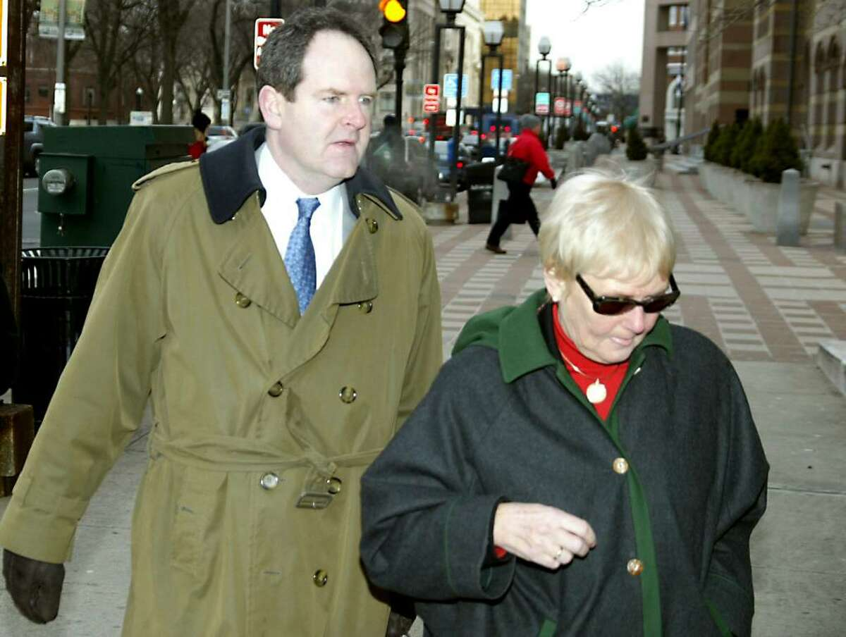 David Grudberg, attorney for Douglas Perlitz, leads Cheryl Perlitz, Douglas Perlitz's mother, into the Federal Courthouse in New Haven, Tuesday, Feb. 2, 2010. Douglas Perlitz, a Fairfield University graduate, is accused of sexually abusing Haitian boys who his charity supposedly was helping.