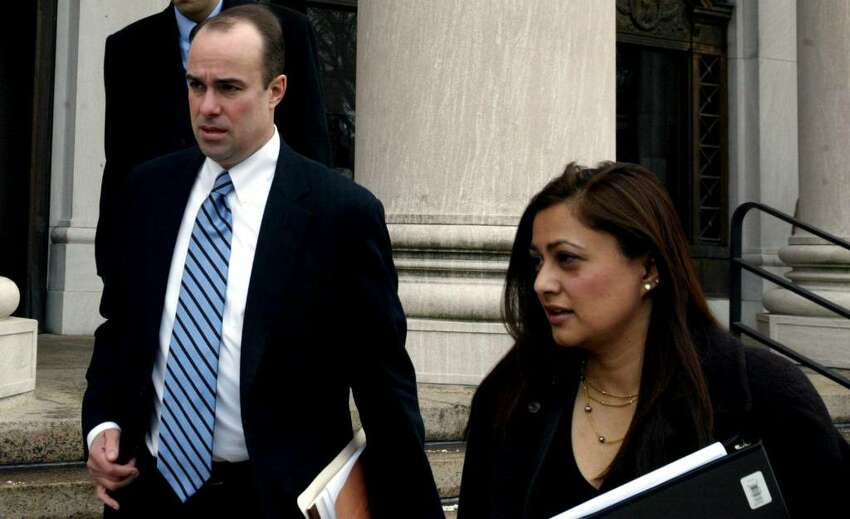 Assistant U.S. Attorneys Stephen Reynolds and Krishna Patel, who are prosecuting Douglas Perlitz, leave the Federal Courthouse in New Haven on Feb. 2, 2010. Perlitz, a Fairfield University graduate, is accused of sexually abusing Haitian boys who his charity supposedly was helping.