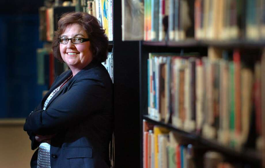 Fairfield Public Library's new head librarian Karen Ronald stands in the stacks Tuesday Feb. 2, 2010. Photo: Autumn Driscoll / Connecticut Post