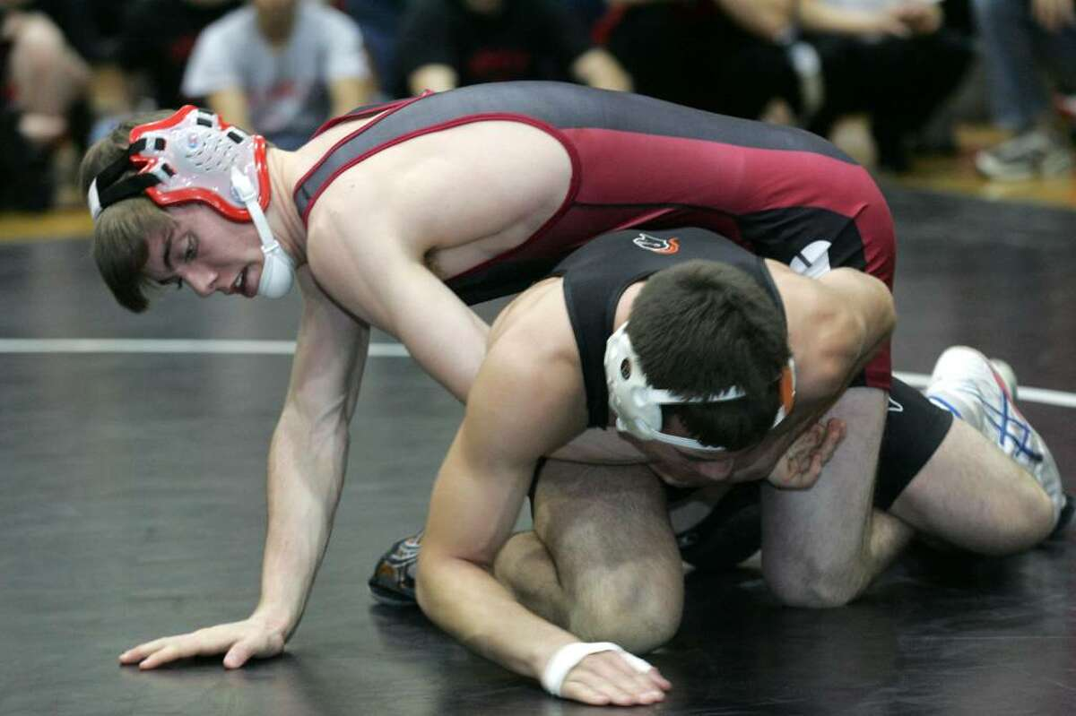 Greenwich High School's Jay Cummiskey and Stamford's Bryan Polanig wrestled in the 145 pound weight class during Tuesday evenings meet at Greenwich High.
