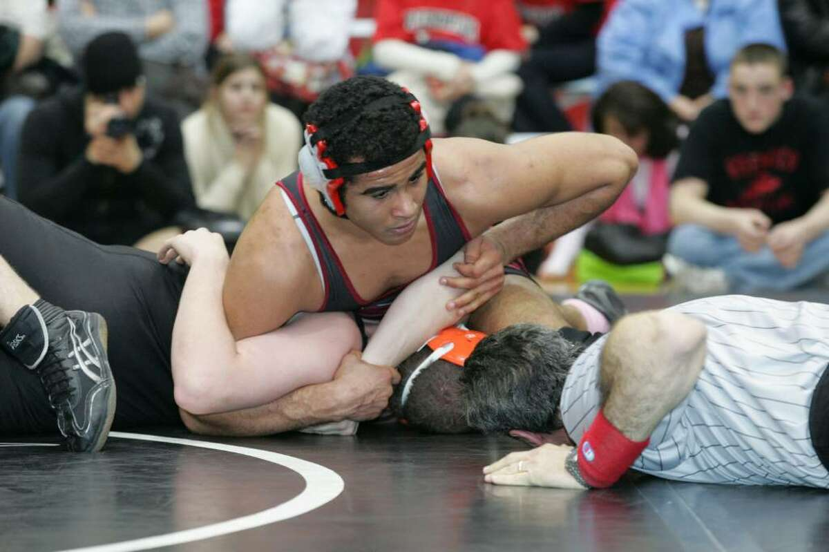 Greenwich High School's Montel Williams waits for the refferee's call during his match against Stamford's Andrew Wallman at Tuesday evenings meet in Greenwich.