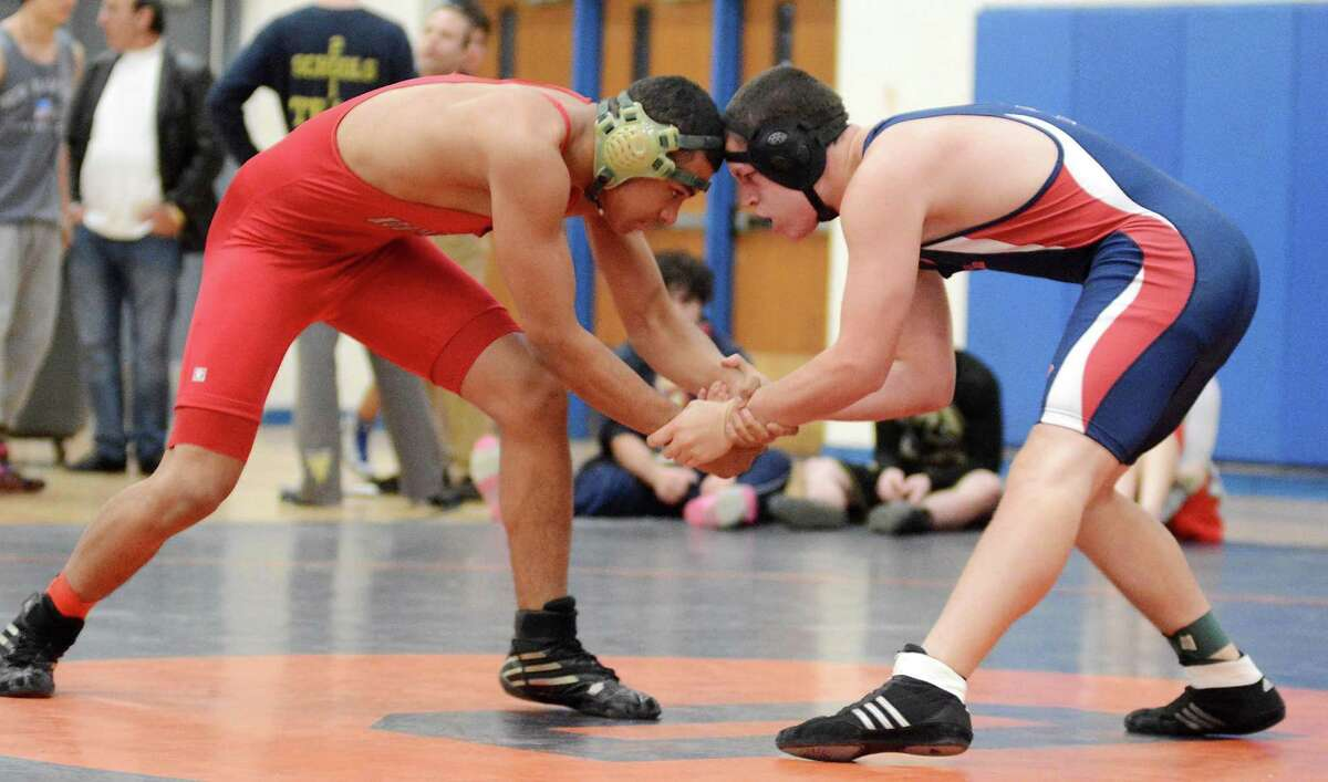 New Fairfield High Schools Andrew Vazquez, right, wrestles against Northeasterns Matthew Nieves in the 170 lb weight catagory during the Danbury Holiday Wrestling Tournament at Danbury High School on Saturday Dec. 28, 2013.