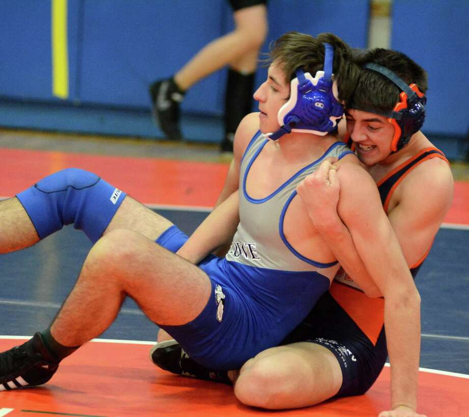 Danbury High Schools Steven Beckham, right, wrestles against Ludlowes Konstantine Suvorov in the 152 lb weight catagory during the Danbury Holiday Wrestling Tournament at Danbury High School on Saturday Dec. 28, 2013. Photo: Lisa Weir / The News-Times Freelance