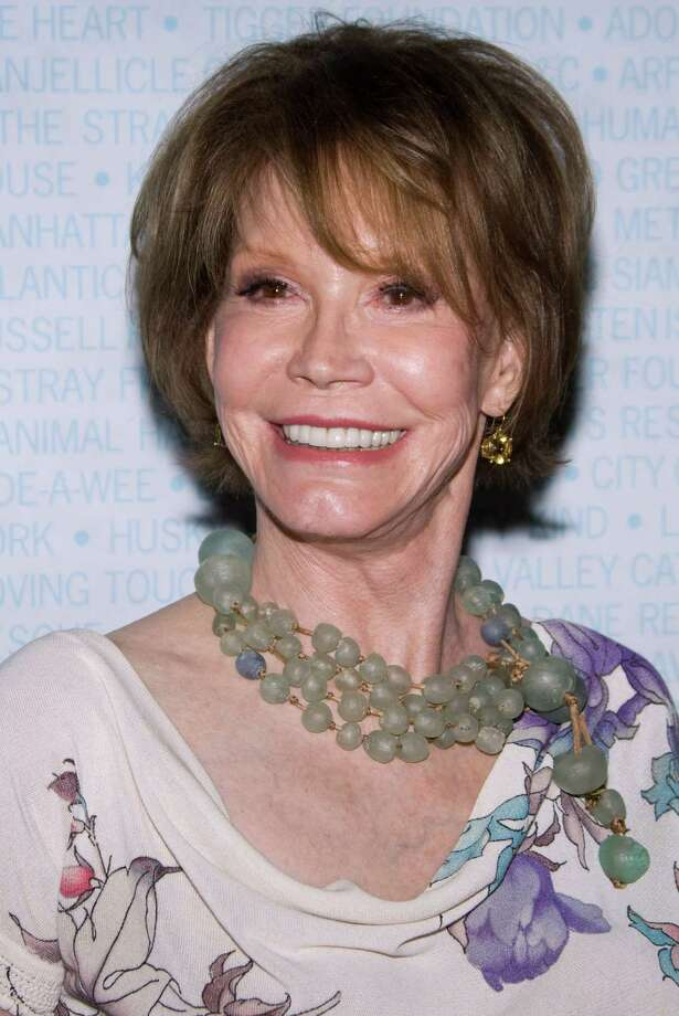 FILE - In this July 11, 2009 file photo, actress Mary Tyler Moore attends Broadway Barks 11 in New York. A representative for Moore says the veteran sitcom star will have surgery to remove a brain tumor, The Associated Press reports Thursday, May 12, 2011. (AP Photo/Charles Sykes, File) Photo: Charles Sykes / AP2009