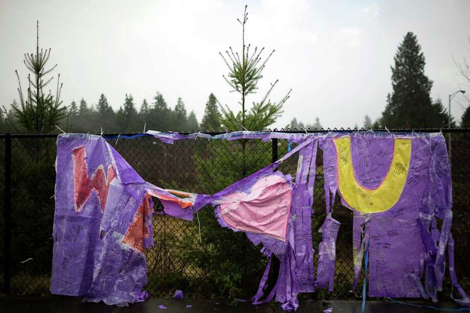A tattered and rain-soaked tribute to Eastside Catholic's former Vice Principal Mark Zmuda hangs from a fence Saturday, Dec. 28, 2013, outside of Eastside Catholic High School in Sammamish. Photo: JORDAN STEAD, SEATTLEPI.COM / SEATTLEPI.COM