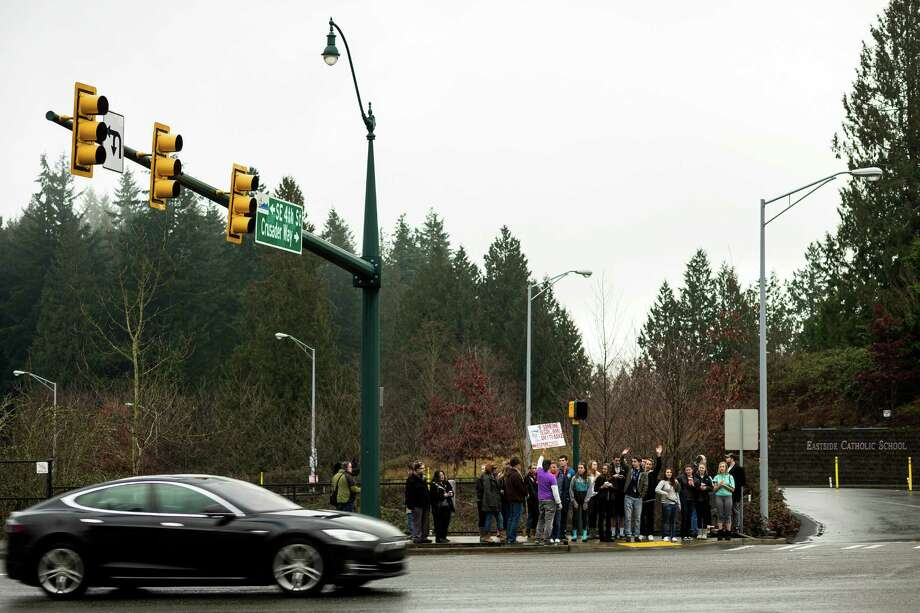 As cars whipped by honking, a crowd of nearly 30 students rallied for Eastside Catholic's former Vice Principal Mark Zmuda, who resigned his position after officials with the Archdiocese discovered that he was in a same-sex marriage and said he violated his contract Saturday, Dec. 28, 2013, outside of Eastside Catholic High School in Sammamish. Photo: JORDAN STEAD, SEATTLEPI.COM / SEATTLEPI.COM