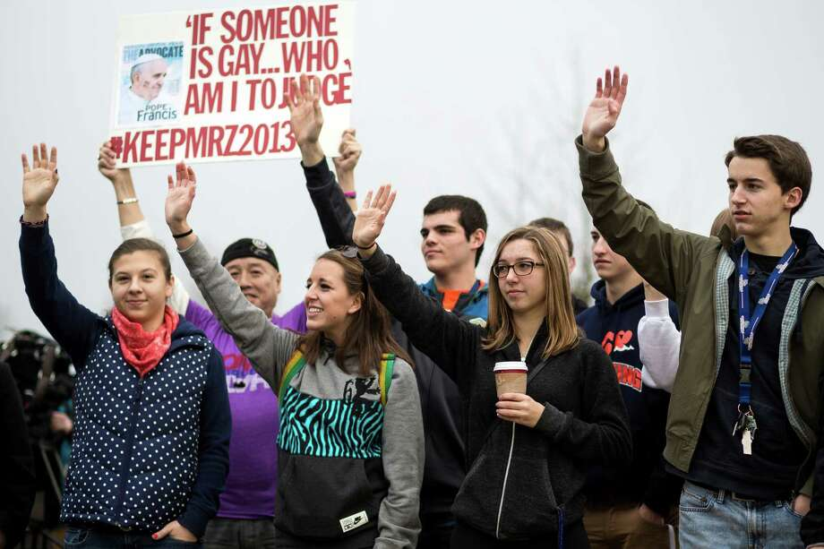 A crowd of nearly 30 students rallied for Eastside Catholic's former Vice Principal Mark Zmuda, who resigned his position after officials with the Archdiocese discovered that he was in a same-sex marriage and said he violated his contract Saturday, Dec. 28, 2013, outside of Eastside Catholic High School in Sammamish. Photo: JORDAN STEAD, SEATTLEPI.COM / SEATTLEPI.COM