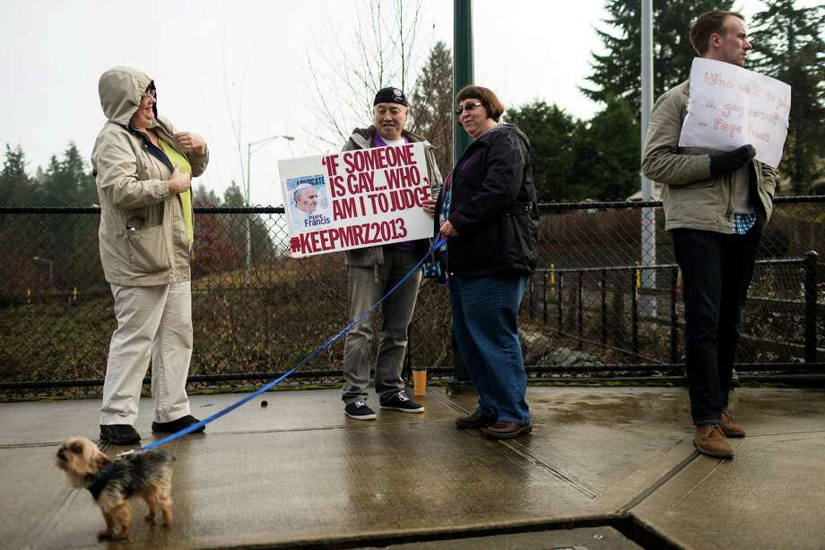 Students and supporters gather to rally for Eastside Catholic's former Vice Principal Mark Zmuda, who resigned his position after officials with the Archdiocese discovered that he was in a same-sex marriage and said he violated his contract Saturday, Dec. 28, 2013, outside of Eastside Catholic High School in Sammamish. Photo: JORDAN STEAD, SEATTLEPI.COM / SEATTLEPI.COM