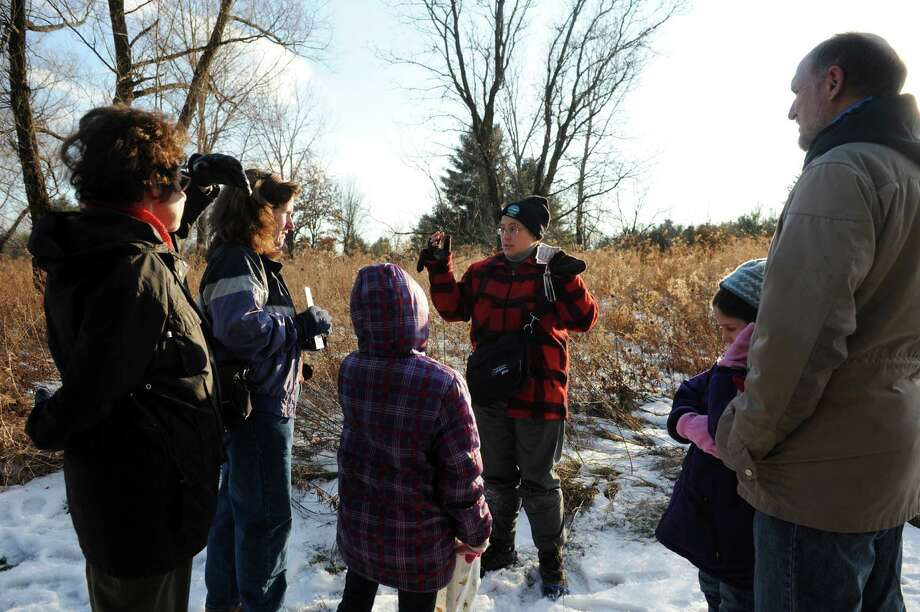 Environmental educator Anik Gibeau of the Department of Environmental Conservation, center, leads a group on a walk to identify animal tracks on Saturday, Dec. 28, 2013, at Five Rivers Environmental Education Center in Delmar, N.Y. (Cindy Schultz / Times Union) Photo: Cindy Schultz / 00025146A