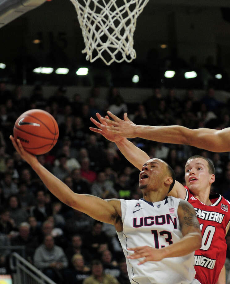 UConn's Shabazz Napier lays up under the basket, during men's basketball action against Eastern Washington at the Webster Bank Arena in downtown Bridgeport, Conn. on Saturday December 28, 2013. This is the first time the men's basketball team is playing in Bridgeport. Photo: Christian Abraham / Connecticut Post