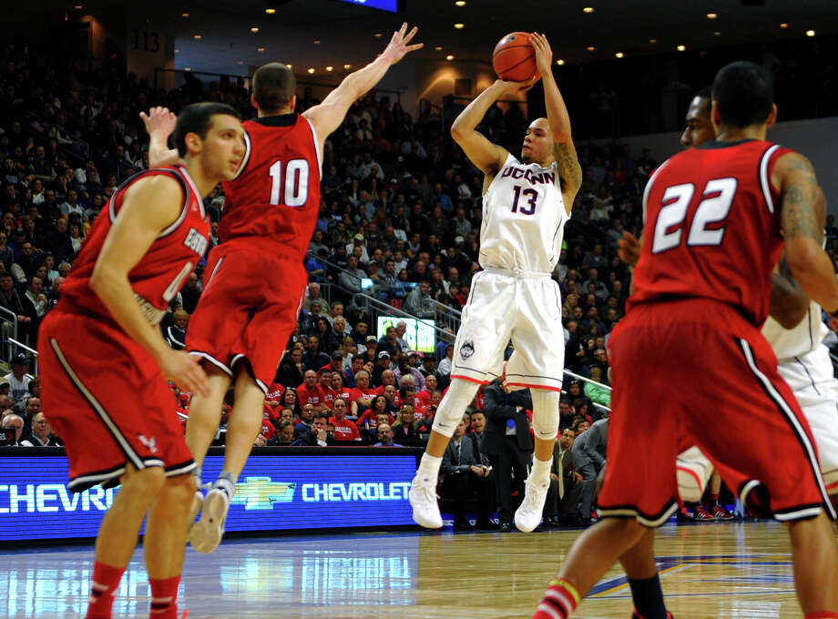 UConn's Shabazz Napier atempts a jump shot, during men's basketball action against Eastern Washington at the Webster Bank Arena in downtown Bridgeport, Conn. on Saturday December 28, 2013. This is the first time the men's basketball team is playing in Bridgeport. Photo: Christian Abraham / Connecticut Post
