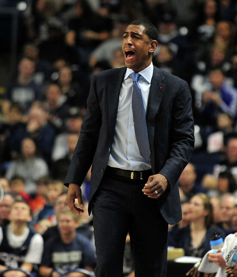 UConn Head Coach Kevin Ollie, during men's basketball action against Eastern Washington at the Webster Bank Arena in downtown Bridgeport, Conn. on Saturday December 28, 2013. This is the first time the men's basketball team is playing in Bridgeport. Photo: Christian Abraham / Connecticut Post