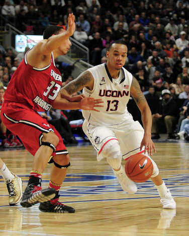 UConn's Shabazz Napier tries to get past Eastern Washington's Garrett Moon on the way to the basket, during men's basketball action at the Webster Bank Arena in downtown Bridgeport, Conn. on Saturday December 28, 2013. This is the first time the men's basketball team is playing in Bridgeport. Photo: Christian Abraham / Connecticut Post