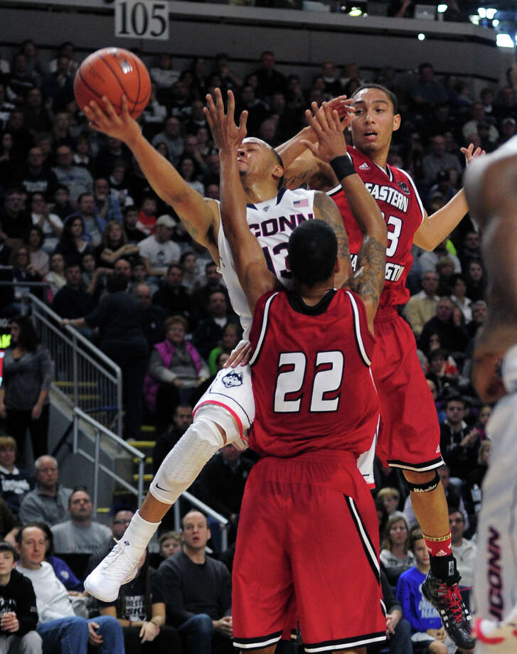 UConn's Shabazz Napier tries to get past Eastern Washington's Drew Brandon and Garrett Moon, in back, on the way to the basket, during men's basketball action at the Webster Bank Arena in downtown Bridgeport, Conn. on Saturday December 28, 2013. This is the first time the men's basketball team is playing in Bridgeport. Photo: Christian Abraham / Connecticut Post