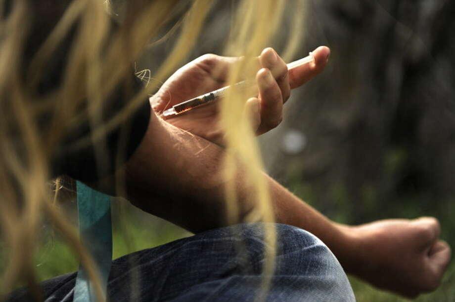 C. heroin Photo: Joe Amon, Andrew Merrill / Denver Post