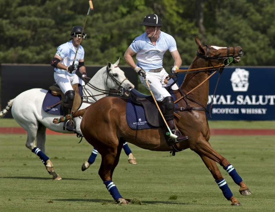 B. Played in a charity polo match Photo: Andrew Merrill