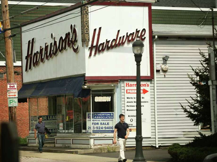 What new business opened in 2013 at the former Harrison's Hardware Store in Milford?