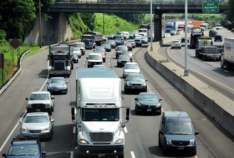 According to a study by Texas A&M Transportation Institute, how much time do Fairfield County commuters lose while sitting in traffic each year?