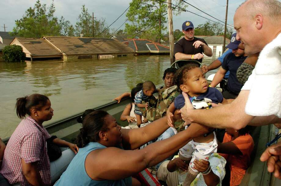 Then-Louisiana Lt. Gov. Mitch Landrieu helps in 2005 in New Orleans after Katrina hit. Suits against the Army Corps of Engineers have been dismissed. Photo: MELISSA PHILLIP, STAFF / HOUSTON CHRONICLE