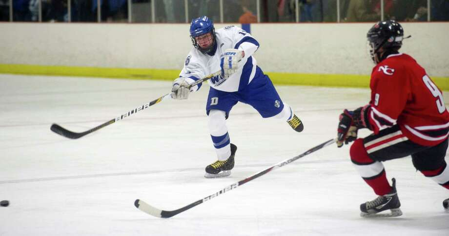 Darien's Nic Tuzinkiewicz controls the puck during Saturday's boys hockey game against New Canaan at the Darien Ice Rink in Darien, Conn., on December 28, 2013. Photo: Lindsay Perry / Stamford Advocate
